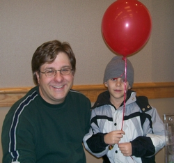 David Kalvitis at Rochester Children's Book Fair with son